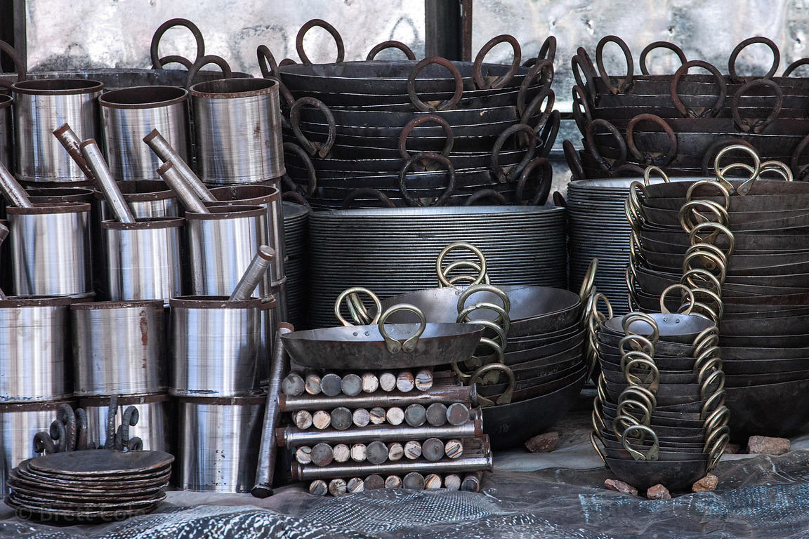 Metal pots for sale at a market in Pushkar, India.