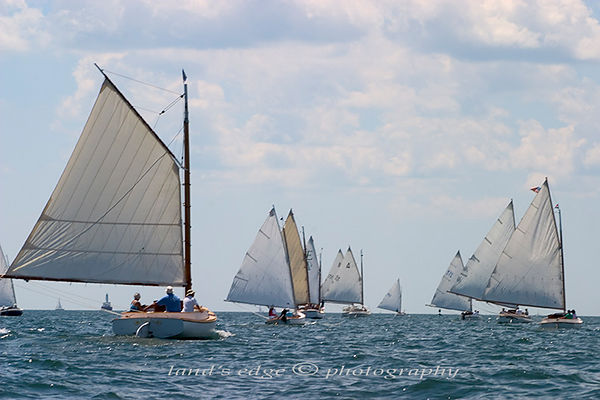the fleet of catboats heading for the green buoy off Cleveland Ledge at the Squeteague Harbor catboat rendezvous