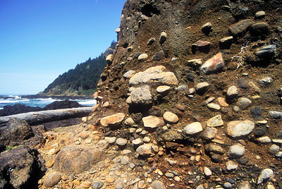 Erosion reveals sedimentary layers along the beach near Cape Perpetua, Oregon Coast.