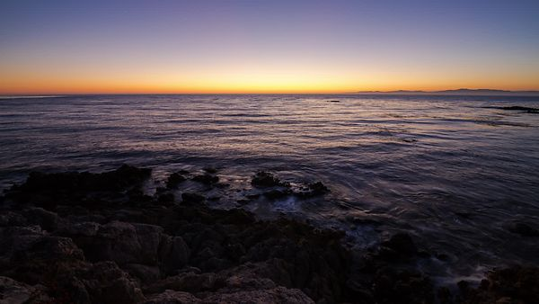 Wide Shot: Sunset Over the Rugged Coastline of Palos Verdes (Day To Night)