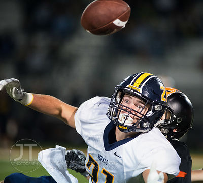 Iowa City Regina's Jacob Phillips (21) reaches out to attempt to catch a pass as Solon's Jackson Pipolo (8) defends during th...