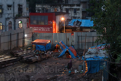 Nighttime view of a construction site near the Bandra Railway Station, Mumbai, India. Taken from the elevated Bandra Skywalk.