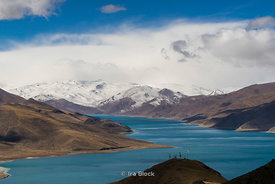 Yamdrok Lake, also known as Yamdrok Yumtso or Yamzho Yumco, one of the three largest sacred lakes in Tibet..Scenes on the roa...