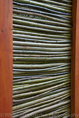 A willow, wind protection screen in The SAC Strutt & Parker Sustainable Highland Garden at RHS Chelsea Flower Show. © Rob Whi...