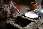 A man boils noodles in the traditional manner