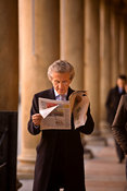 Italy - Bologna - An businessman reads his morning newspaper