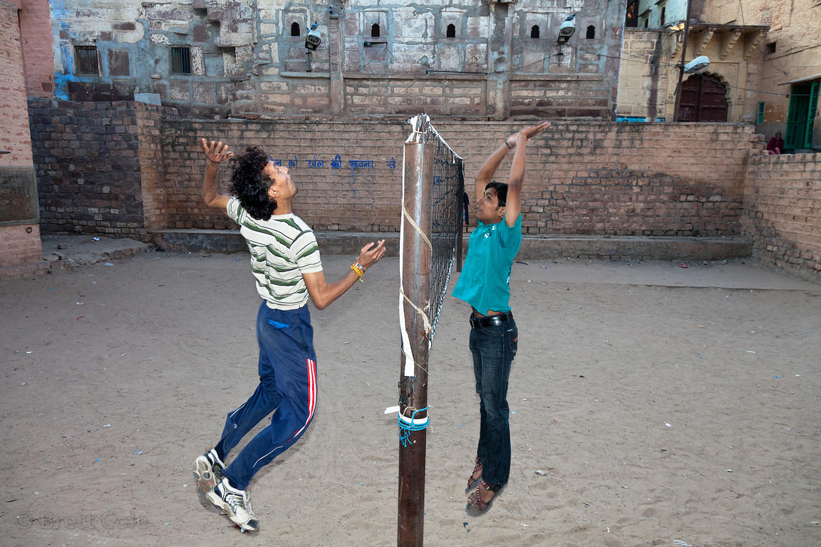 Two boys play volleyball in a secluded courtyard in Jodhpur, Rajasthan, India