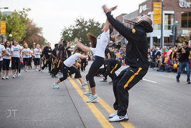 Members of the UI Gymnastics team perform in the  University of Iowa homecoming Parade on Clinton St in Iowa City on Friday S...
