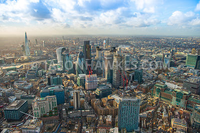 Aerial view of City of London with St Botolph's Building and construction of 70 St Mary Axe, 100 Bishopsgate, 22 Bishopsgate ...