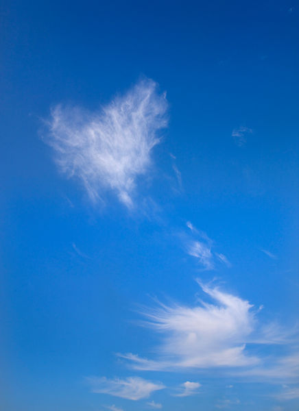 View of heart shape cloud in the blue sky