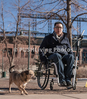 Man using a wheelchair walking his dog with the Orochi Scileash