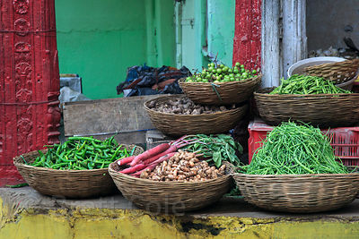 Peas, peppers, and ginger in baskets at a market, Pushkar, Rajasthan, India