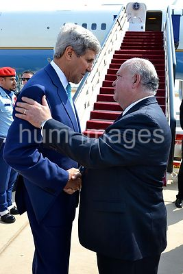 U.S. Secretary of State John Kerry speaks with Ambassador Joseph W. Westphal before his departure at Royal Terminal of King A...