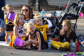 Siena Bell, 2, Lila Bell, 6, Gwen Bell, Sofie Bell, 4, Bella Pourroy, 5, Rylee Pourroy, 5 watch as the 2012 University of Iow...