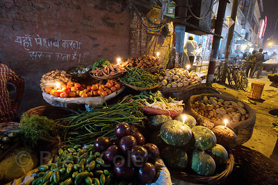 Candles adorn a magnifient vegetable cart during the Diwali festival, Sonapura, Varanasi, India