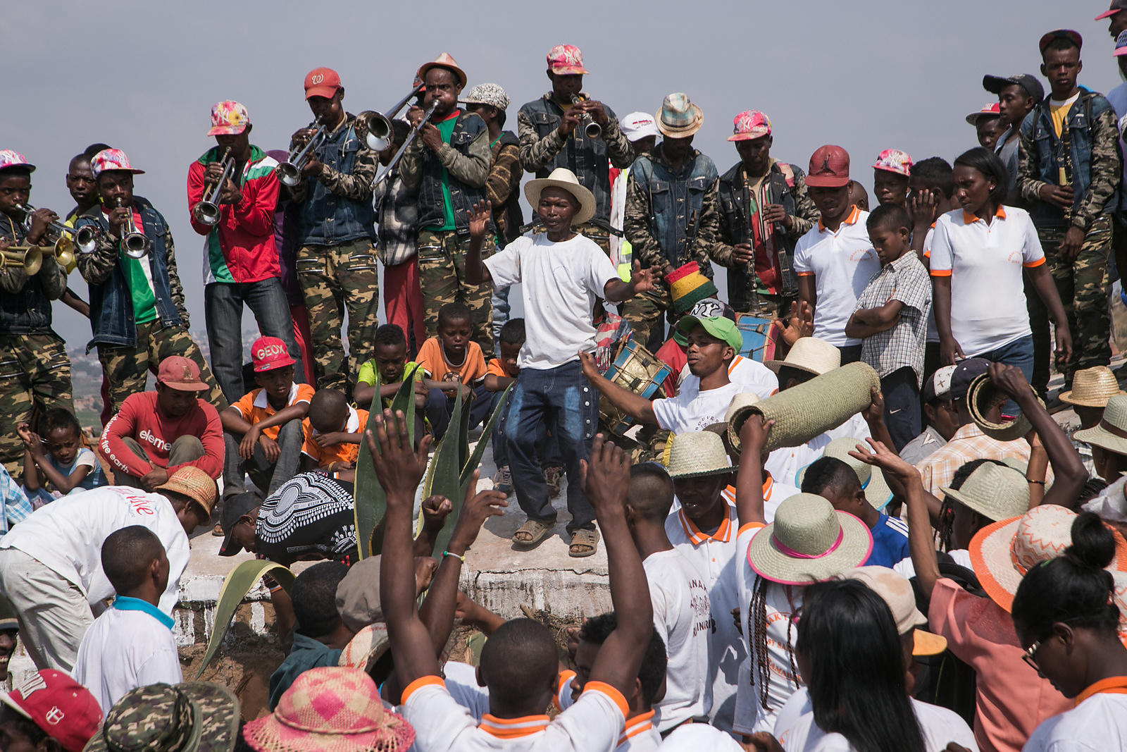 "People dance, sing and play music as they carry the bodies of their ancestors during a funerary tradition called the Famadihana in the village of Ambohijafy, a few kilometres from Antananarivo, on September 23, 2017. During the Famadihana, which can be translated as ""turning of the bones"", several crypts are opened and people take the bodies of their ancestors from the family crypts and rewrap them in fresh cloth, then dance with the corpses in their arms at the pace of traditional Malagasy band's music. The Famadihana is a pillar in the Malagasy ancestor's worship and is celebrated each three, five or seven years."