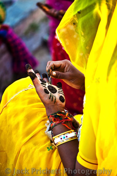 Rajasthan woman applies henna in women's ritual