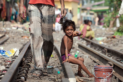 A girl along the railway tracks near Sovabazar Ghat, Kolkata, India.