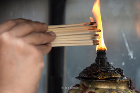 Fire for stick of incenses at Erawan Shrine in Bangkok, Thailand.