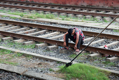 A drunk man passed out on the railway tracks, South Dum Dum, Kolkata, India