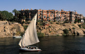 Felucca sailing past the old Cataract hotel in Aswan at the Nile, Egypt