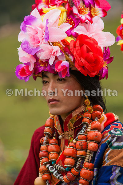 Male monks who portray women in the epic wear floral headdresses and jewelry made of coral and silver. In Tibetan culture, je...