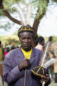 Karamojong man selling hats made with human hair, Moroto cattle market, Uganda