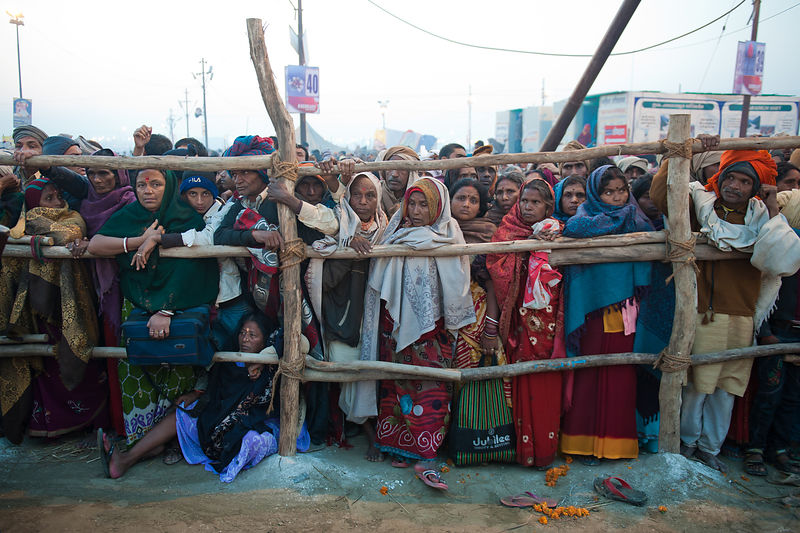 Pilgrims wait for their turn to offer prayers during the Kumbh Mela, Allahabad