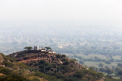 Small hilltop temple near Narwar village, Rajasthan, India, seen from the pass over the Aravali Range to the village of Banwal