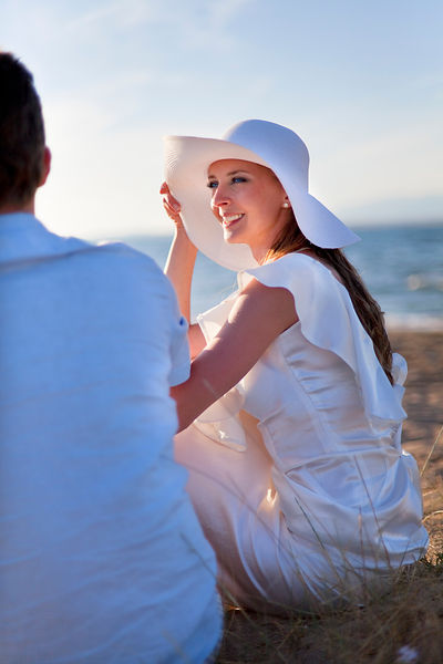Bride sitting on beach