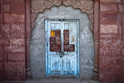 Grafitti on an arched doorway of an abandoned building, Jodhpur, Rajasthan, India