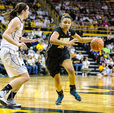 Iowa's Bethany Doolittle (51) defends Purdue's Liza Clemons (23) during the first half of play at Carver-Hawkeye Arena in Iow...