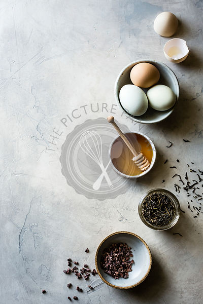 Honey, eggs, tea, cacao nibs on a light background