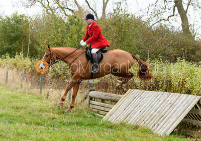 Andrew Osborne jumping a hunt jump near Peake's. The Cottesmore Hunt at Somerby