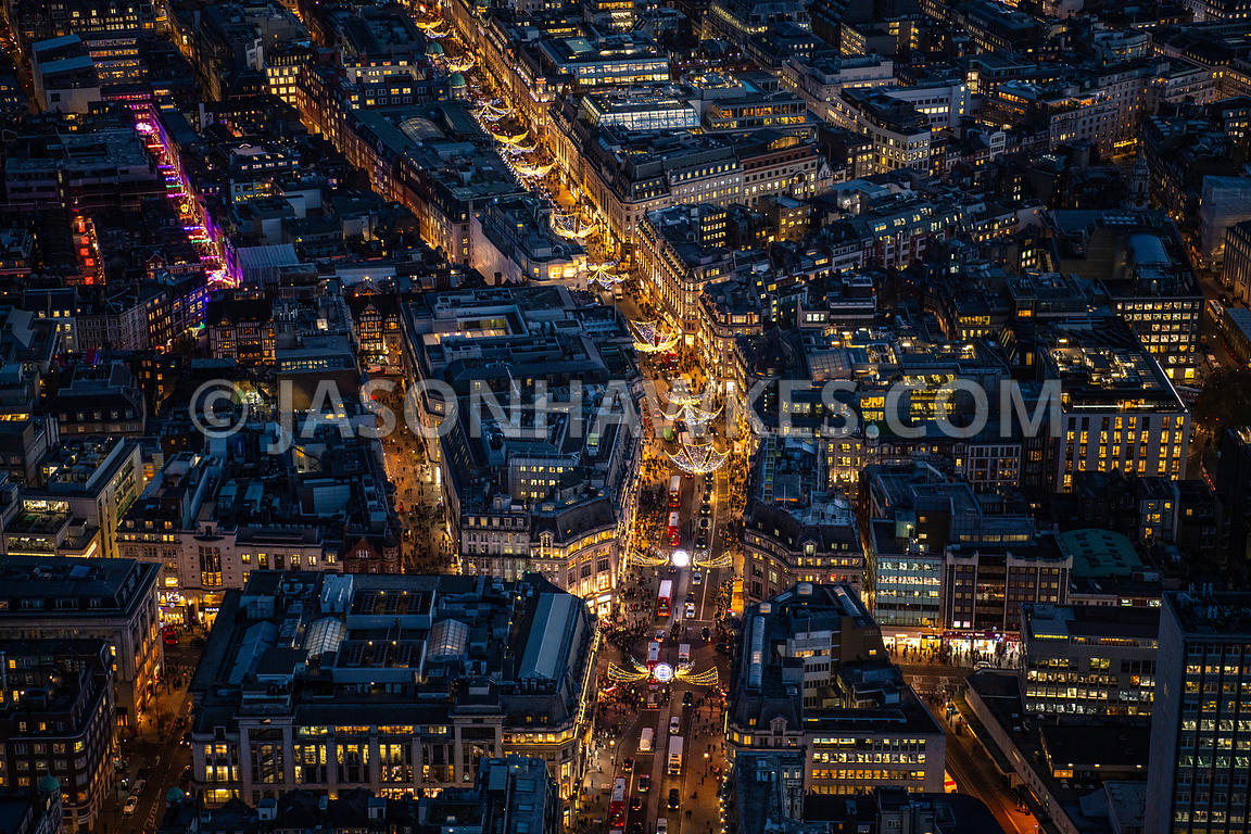 Night aerial view of Christmas lights on Oxford Circus and Regent St, London.