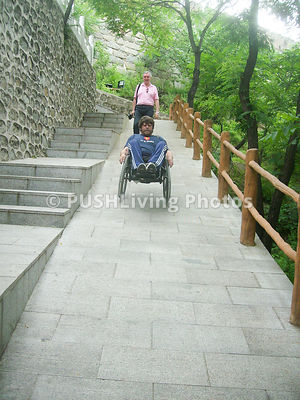 Man in a wheelchair descending the Great Wall of China