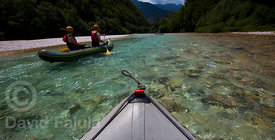 mini-raft paddling the waters of Soča river