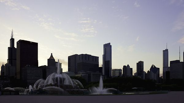 Wide Shot: Light & Water Show Of Buckingham Fountain Backdropped By Chicago's Skyline