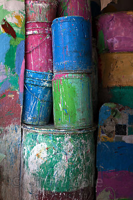 Pastel colored barrels in a family-run paint shop in the Dharavi slum, Mumbai, India.