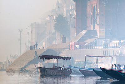 Misty winter morning on the Ganges River, Varanasi, India.