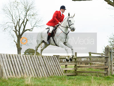 Chris Edwards jumping a hunt jump near Peake's. The Cottesmore Hunt at Somerby