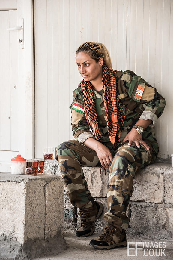 PAK (Kurdistan Freedom Party) female fighter taking a tea break at her base north of Hawija, where Kurdish Iranian fighters a...