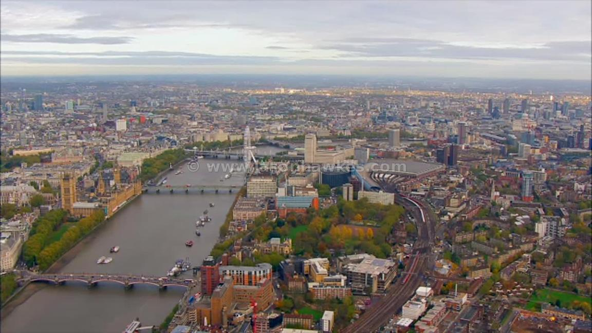 Aerial footage of the London Eye and Waterloo Station, London