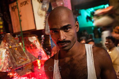 Portrait of a manual laborer at the Kole wholesale vegetable market, Bowbazar, Kolkata, India. Kole is one of the largest veg...