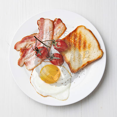 Breakfast with Fried egg and bacon on plate