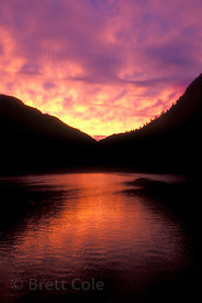 Deep red, purple and yellow sunset over Spiller Inlet in the Ingram-Mooto Wilderness, heart of the Great Bear Rainforest, Bri...