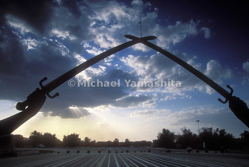 The Iran War Memorial displays two swords crossing on one end.