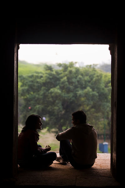 India - New Delhi - A young romantic couple sit in a window of the ruins of a Madrassa in Hauz Khas built by the 14th century...