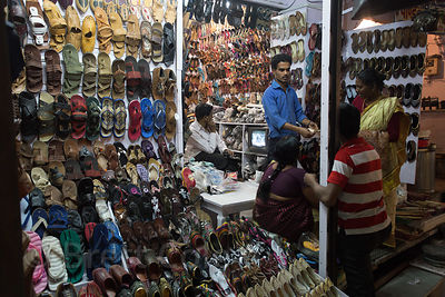 Shoe shoppers at night, Pushkar, Rajasthan, India