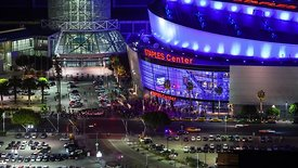 Medium Shot: Intense Foot & Vehicle Traffic Swarming Staples Center In Neon Lights